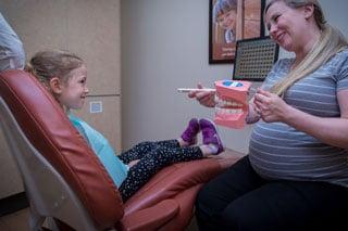 Kids Dentist Langley - image of little girl in dentist chair